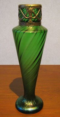 Bohemian iridescent green vase with metal collar